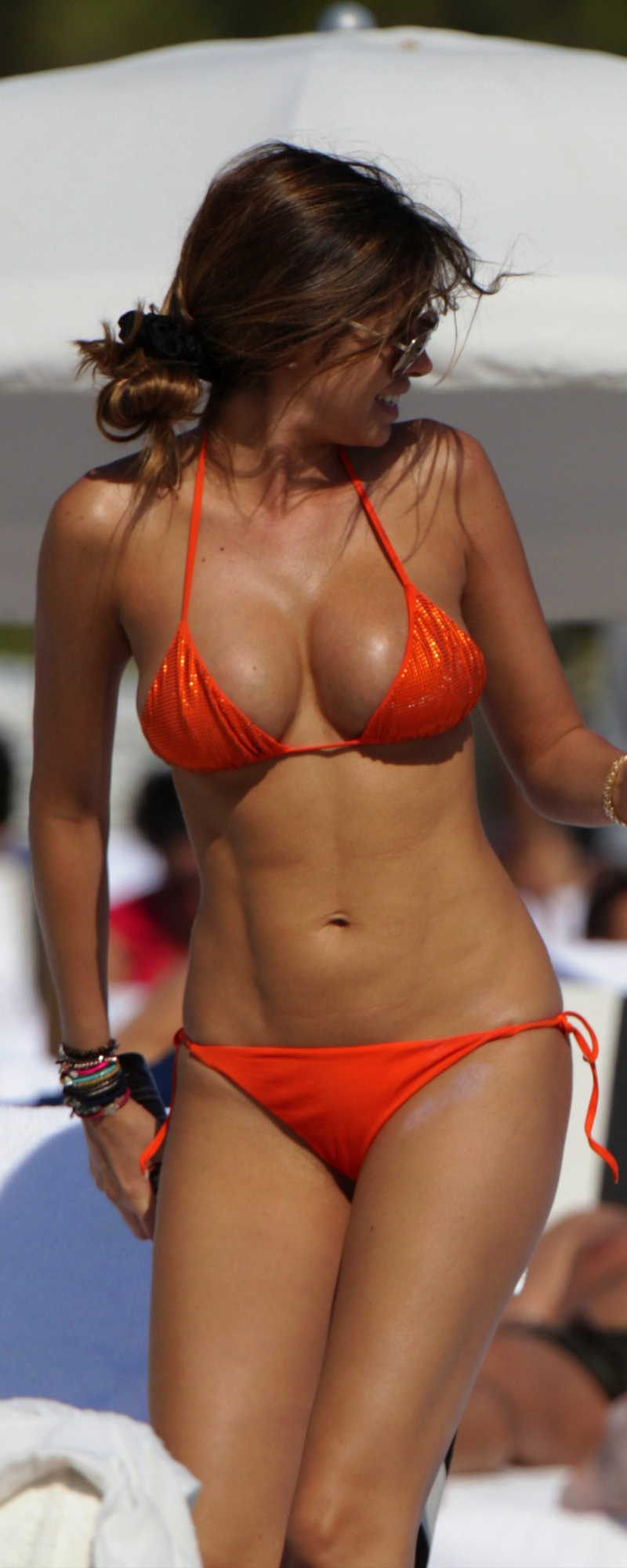 Aida Yespica at the beach in Miami wearing an orange bikini
